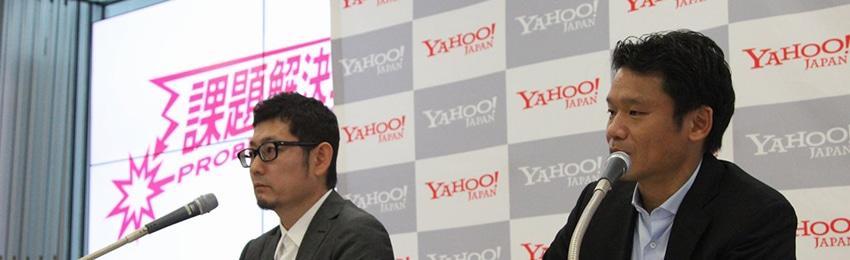株主・投資家のために。宮坂代表取締役社長、大矢副社長執行役員が株主総会でマイクを前に話す写真。
