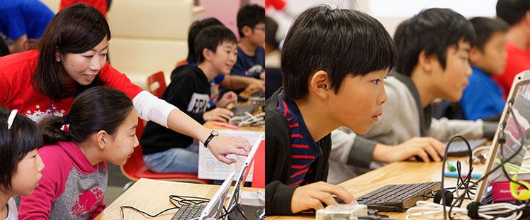 プログラミング講座、スタート!わからないところはチューターに聞きながら作業を進めていく子供たちの画像