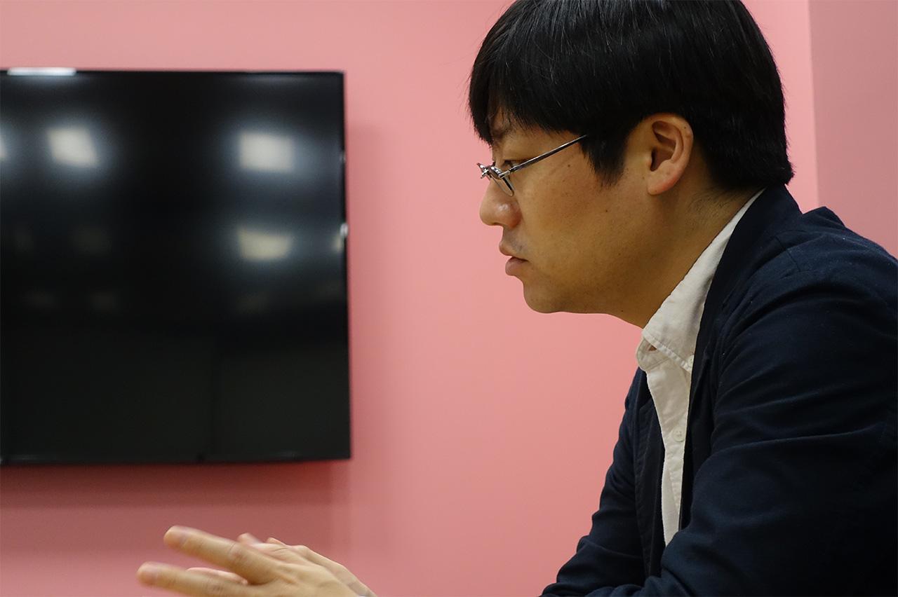 モザンビークで展開する電子マネーシステムについて語る合田真さん
