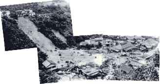 がけ崩れにより倒壊した家屋(神戸市長田区明泉寺町):観測史上最大の時間雨量を記録し、六甲山系において2,500箇所以上の土石流やがけ崩れが発生しました。生田川上流の布引谷の市ケ原では、大規模な斜面崩壊が発生し、山麓に住む21人が家もろとも犠牲になりました。